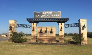 Lewisville railroad park entrance sign