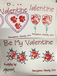 paw prints in red painted inside hearts flowers and bugs for Valentines Day